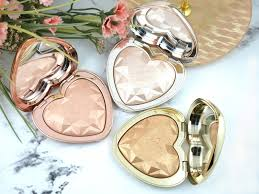 love light prismatic highlighter too faced love light prismatic highlighter review and swatches