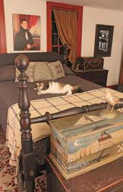 furnishing a bedroom in a colonial house old house restoration the cannonball bed with distinctive turnings for both head and footboards dates to