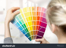 woman selecting home interior paint color stock photo 619167758