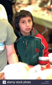 boy age 7 in line at soup kitchen thanksgiving dinner exchange