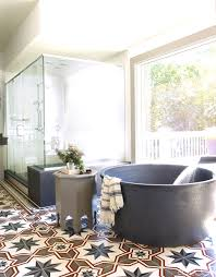 bathroom bath tub moroccan cement tile floor glass shower bobby