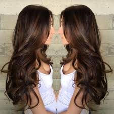 long curled chocolate brown hair with caramel highlights