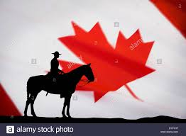 canadian police officer on horse against background of canadian