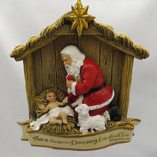 santa kneeling at the manger joseph studio kneeling santa baby jesus christmas ornament by