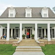 plantation style home with wraparound porch columns and brick