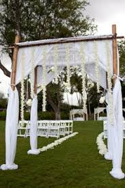 wedding arches using tulle looks easy and is beautiful even if it wasn t bamboo with a