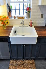 farmhouse kitchen sink kitchen transitional with blue backsplash