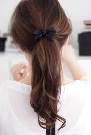 ribbon ponytail demure tousled pony with ribbon bow hairstyles weekly