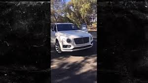 tyga yellow bentley kylie jenner buys tyga a 300k bentley bentayga video edm honey