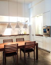 furniture showroom design ideas by nodesign a white kitchen in multiform s copenhagen showroom the elegant dining table and chairs add an download image furniture showroom design ideas