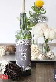 Table Numbers Wedding Diy Wedding Table Numbers Wax Decorated Wine Bottles The Elli Blog
