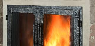living room black wrought iron scribed gas fireplace doors