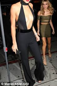 plunging jumpsuit kendall jenner shows chest in plunging jumpsuit as she