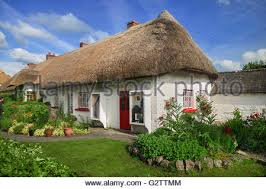 Thatched Cottage Ireland thatched cottage in village adare county limerick ireland stock