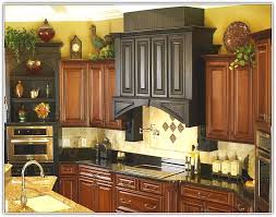 Decorating Above Kitchen Cabinets Pictures by Decorating Above Kitchen Cabinets Tuscan Style Bathroom Decor