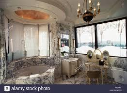 marble bathroom suite and jacuzzi bath in suite la belle etoile