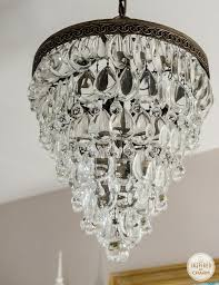 Pottery Barn Fixtures these rain and sea life motif chandeliers bring the beauty of