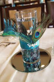 peacock centerpieces peacock centerpiece maybe a floating candle in the water