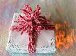 doily holiday gift wrap plus make a yarn pom pom hgtv