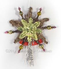 victorian angel on bell with tinsel star tree topper and glass