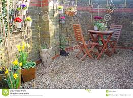 small courtyard garden stock photo image of pretty chairs 38767940