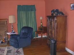earthy pink paint color on my living room walls