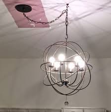 librarian tells all the orb chandelier from ballard designs the orb chandelier from ballard designs