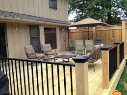pressure treated decking with cedar posts and privacy panels