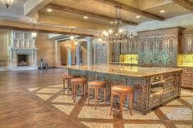 mediterranean kitchen with flat panel cabinets u0026 chandelier