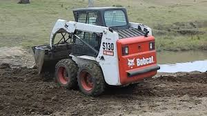how to operate a bobcat s130 skid steer loader youtube