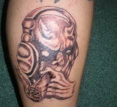 thug skull smoking cigar tattoo design photos pictures and