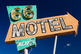 route 66 needles 66 motel sign with arrow road trip inspired