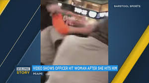miami fan slaps officer video university of miami fan swings at officer gets punched back