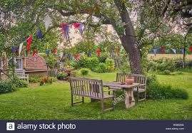 Pretty Bunting Flags Cottage Garden With Bunting Flags On A Summer Day Stock Photo