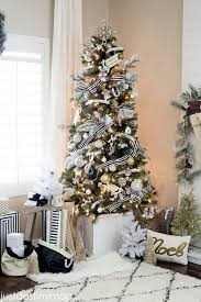 tree with gold ornaments plus black and white striped