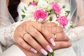 girls rings hands images He image of two hands with a wedding ring stock photo colourbox jpg