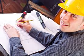 happy architect working on blueprint of house close up stock