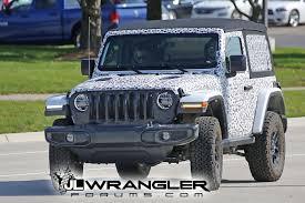 white jeep wrangler 2 door spied wrangler 2 door jl rubicon soft top and export jl sport