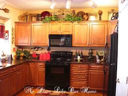 ideas for top of kitchen cabinets kitchen kitchen cabinets top decorating ideas brown rectangle
