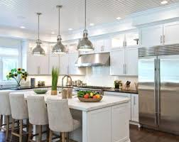 pendant lights in kitchen and plug light over island with