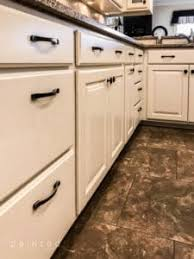 white kitchen cabinets rubbed bronze hardware how to change cabinet knobs to pulls rubbed bronze