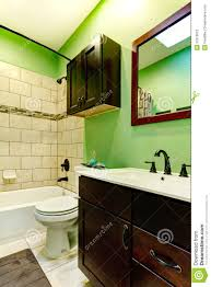 elegant bathroom with green wall tile decorated wall dark brown
