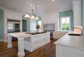 interior blue tile kitchen backsplash and white marble