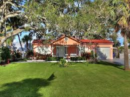 landward drive jupiter fl 33477 river at the bluffs beautiful old florida riverfront retreat cottage style home 2 bed 2 bath 1 car attached also 2 plus detached garage 28x22