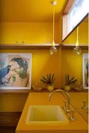 yellow bathroom paint ideas with wall art and open shelf yellow