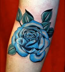 this beautiful red rose tattoo on the shoulder is a symbol of love
