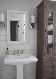 bathroom linen cabinet with glass doors glass front bathroom linen cabinet transitional bathroom