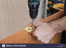 Interior Door Install by Door Carpenter U0026 Close Up Of A Carpenter Fitting Wardrobes Using A