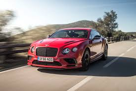 bentley coupe red behind the wheel of the 209 mph bentley continental supersports