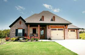 plan 915018chp acadian house plan with unique garage layout